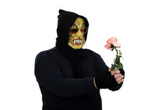 Black monster holding a pink rose. Black masked monster holding pink rose on a white background Stock Images