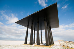 Black monument at seawall Stock Photography