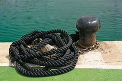 Black mooring knob and rope. In the marina of Puerto Portals in Mallorca, Spain Royalty Free Stock Photos