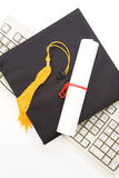 Black Mortarboard and computer keyboard Royalty Free Stock Photo