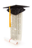 Black Mortarboard and computer keyboard. Online learning Royalty Free Stock Photos