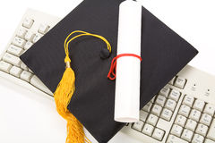 Black Mortarboard and computer keyboard Royalty Free Stock Images