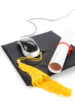 Black Mortarboard and computer mouse Royalty Free Stock Photo