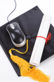 Black Mortarboard and computer mouse Royalty Free Stock Photos