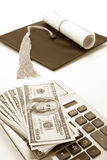 Black Mortarboard and dollar Royalty Free Stock Photo