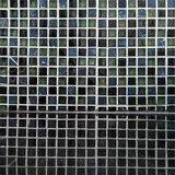 Black mosaic ceramic tiles with reflection. For tiling royalty free stock photography