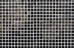 Black mosaic. Detail of a wall with black tiles Royalty Free Stock Photos