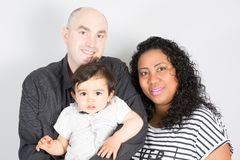 Black Mother and father Happy multiethnic family with children son. And looking at camera stock photography