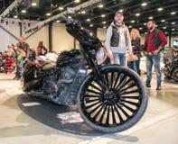 Black motobike with original wheel. Royalty Free Stock Photos