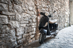 Black motor scooter as a traditional Italian transport in Bergamo town, Italy Royalty Free Stock Photo
