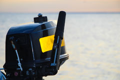 Black Motor. Black and yellow motor for the rubber boat and sea Stock Photos