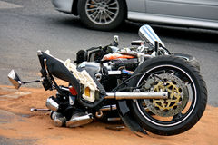 Black motorbike accident on the asphalt road Royalty Free Stock Photography