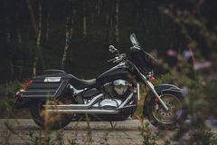 Black motorcycle bagger on the roadside Stock Photo