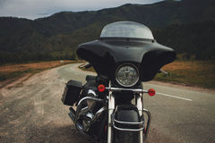 Black motorcycle bagger on the roadside Royalty Free Stock Photography