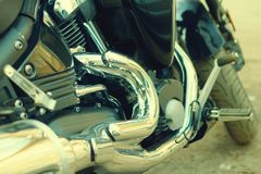 Black motorcycle close-up. Background texture speed chrome detail custom chopper bike classic vintage fashion trend style recreation relax hobby race strong royalty free stock photos