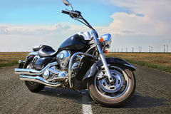 Black motorcycle on highway in country Royalty Free Stock Images