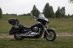 Black motorcycle on the lawn Royalty Free Stock Image