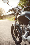 Black motorcycle on road over nature background Royalty Free Stock Photo