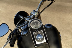 Black Motorcycle Speedometer and Handlbars Royalty Free Stock Images
