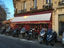 Black motorcycles parked outside a cafe on Ile Saint Louis, Paris Royalty Free Stock Photo