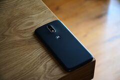 Black Motorola Smartphone on Top of Brown Wooden Table Stock Photo