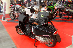 The black motorscooter Stock Image