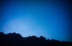 Black mountain with blue sky ,full stars. Black mountain with full stars,blue sky Royalty Free Stock Photography