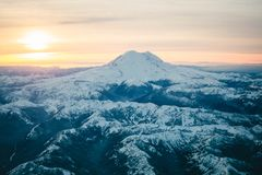 Black Mountain Covered in Snow during Sunset royalty free stock photos