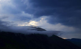 Black Mountain and Dark Clouds Royalty Free Stock Photography