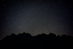 black mountain with full stars royalty free stock photography