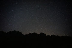 Black mountain with full stars. In the sky Royalty Free Stock Images