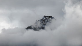 Black Mountain Surrounded by White Clouds Stock Image