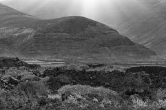 Black mountain in a volcanic land, Lanzarote, Spain Stock Photos