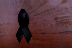 Black mourning ribbon. Mourning concept with black awareness ribbon isolated Stock Images