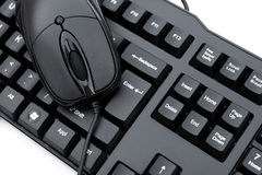 Black mouse and black keyboard Royalty Free Stock Photos