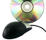 Black mouse and optical data disc. Royalty Free Stock Image