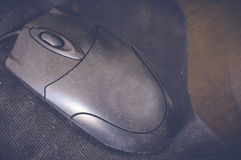 Black mouse on table Royalty Free Stock Image