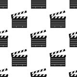 Black Movie Clapboard Seamless Pattern. A seamless pattern with black movie clapboard flat icon, isolated on white background. Useful also as design element for Royalty Free Stock Photos