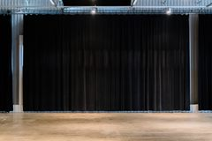 Black movie theater curtains with concrete floors. Empty spare f stock image