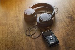 Mp3 music player with headphone. stock photos