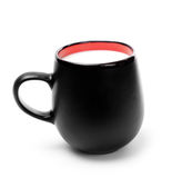 Black mug with milk Royalty Free Stock Images