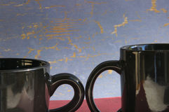 Black mugs. Two coffee mugs royalty free stock image