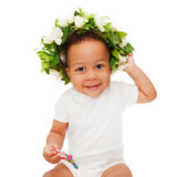 Black mulatto baby with floral wreath Stock Photography