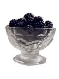 Black mulberries 1. Front view of black mulberries in the glass jam dish royalty free stock images