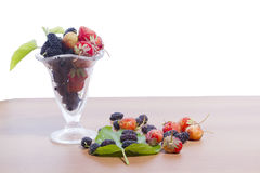 Black mulberry s red strawberries  Stock Photo
