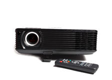 Black multimedia projector. Isolated over white with remote control stock image