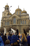 Black mummers and Varna Cathedral Stock Image