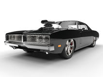 Black muscle car - closeup shot. Isolated on white background Royalty Free Stock Images