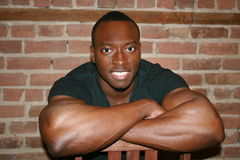 Black muscular man smiling Stock Photography
