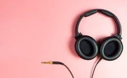Black Music headphone on pink Stock Photography